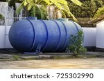 big blue tank of water use in... | Shutterstock . vector #725302990