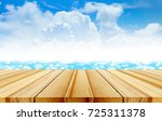 wood table top on blur... | Shutterstock . vector #725311378