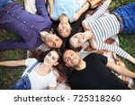 five cheerful friends lying on... | Shutterstock . vector #725318260