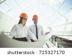 the two engineers hold the... | Shutterstock . vector #725327170
