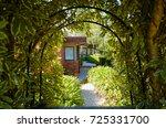 Modern Brick House With Leafy...
