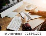 woman designer working on the... | Shutterstock . vector #725341273
