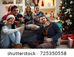 young friends celebrating... | Shutterstock . vector #725350558