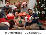 group of friends with gifts... | Shutterstock . vector #725350930