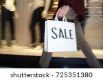 hurrying guy with shopping bag