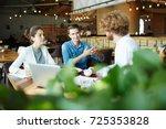 team of young associates...   Shutterstock . vector #725353828