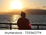 buddhist stands on a bridge and ... | Shutterstock . vector #725362774