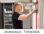 confident male technician... | Shutterstock . vector #725363626