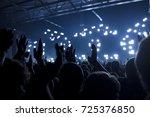 concert goers applauding inside ...   Shutterstock . vector #725376850