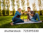 shot of a beautiful couple on a ... | Shutterstock . vector #725395330