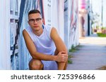 handsome young man portrait in...   Shutterstock . vector #725396866