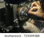 worker use lathe machine to... | Shutterstock . vector #725409388