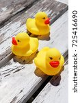 three yellow plastic toy ducks... | Shutterstock . vector #725416690