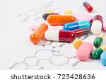 heap of color pills and tablets ... | Shutterstock . vector #725428636