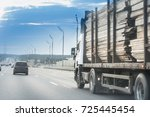 a truck of lumbers moving on... | Shutterstock . vector #725445454