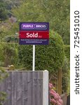 Small photo of LEEDS, UK - 1 OCTOBER 2017. A Purple Bricks estate agency for sale sign showing sold subject to contract