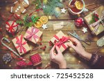 female hands wrapping christmas ... | Shutterstock . vector #725452528