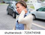 woman feeling pain after car... | Shutterstock . vector #725474548