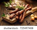 kabanosy  polish sausages made... | Shutterstock . vector #725497408