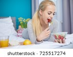 smiling young blond woman lying ... | Shutterstock . vector #725517274