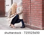 young beautiful mom with her... | Shutterstock . vector #725525650