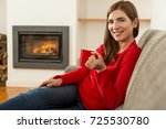 beautiful woman at home... | Shutterstock . vector #725530780