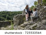 A mother a teenage daughter and teenage son chatting in the outdoors. Taken in Rochechaurt, Limousin, France - stock photo
