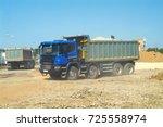 fully loaded modern dump truck... | Shutterstock . vector #725558974