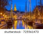 historic sailing ships moored... | Shutterstock . vector #725561473