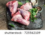 raw lamb shanks with salt and... | Shutterstock . vector #725562109