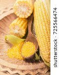 raw corn with green leaves on a ... | Shutterstock . vector #725566474