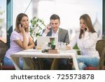 three young and busy business... | Shutterstock . vector #725573878