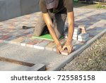 construction worker laying... | Shutterstock . vector #725585158