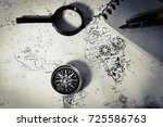 an ancient map  a compass and a ... | Shutterstock . vector #725586763