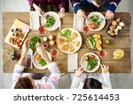 top view of four people eating... | Shutterstock . vector #725614453