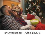 couple in love at christmas eve ... | Shutterstock . vector #725615278