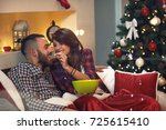 woman feeds her husband with... | Shutterstock . vector #725615410