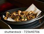 baked delicious champignons...   Shutterstock . vector #725640706