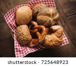 breadbasket with red and white... | Shutterstock . vector #725648923