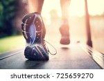 man running in a gym on a... | Shutterstock . vector #725659270