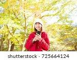 smiling asian woman | Shutterstock . vector #725664124