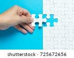 hand put the last piece of... | Shutterstock . vector #725672656