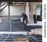 pipe fitter mounting underfloor ... | Shutterstock . vector #725673610