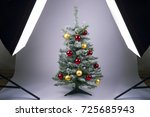 christmas tree on a white... | Shutterstock . vector #725685943