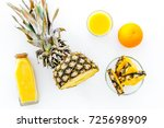 fresh pineapple juice in glass... | Shutterstock . vector #725698909