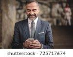 senior business man receiving a ... | Shutterstock . vector #725717674