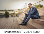 senior business man receiving a ... | Shutterstock . vector #725717680