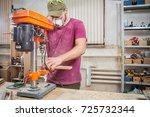 a man carpenter in a cap ...   Shutterstock . vector #725732344