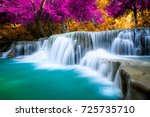 amazing waterfall in colorful... | Shutterstock . vector #725735710