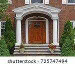 front door with portico | Shutterstock . vector #725747494